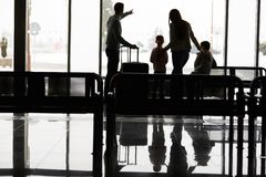 Family and children are waiting at the airport terminal stock images