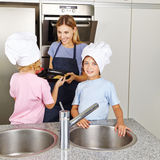 Family with children baking cookies Stock Photography