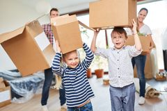 Family and children carry moving boxes royalty free stock image