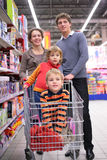 Family with children in cart in shop Royalty Free Stock Photo