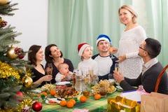 Family with children celebrates Christmas Stock Photos