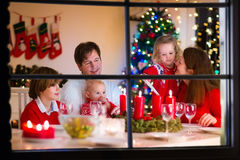 Family with children at Christmas dinner at home royalty free stock photo