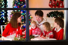 Family with children at Christmas dinner at home stock photos