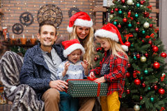 Family , children in Christmas room Royalty Free Stock Photos