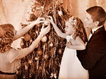 Family with children  dressing Christmas tree. Stock Images