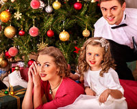 Family with children  dressing Christmas tree Stock Photos