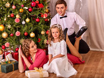 Family with children dressing Christmas tree. Stock Photos
