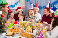Family with children are drinking together Royalty Free Stock Images