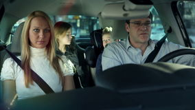 Family with children driving in a car, kids having fun stock footage