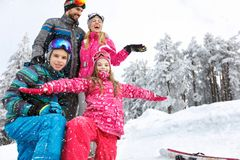 Family with children enjoying on winter vacation in snowy nature. Happy family with children enjoying on winter vacation in snowy nature Royalty Free Stock Photo