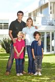 Family with children in front of house in the garden royalty free stock photo