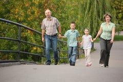 Family with children is handies on bridge. Family with two children is handies on a bridge and walking Royalty Free Stock Image