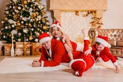 Family with children having fun under the Christmas tree stock photos
