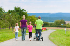 Family with children having walk Royalty Free Stock Photo