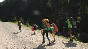Family with children in  hike to the mountains