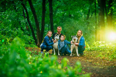 Family with children, and husky dogs in the forest Royalty Free Stock Image