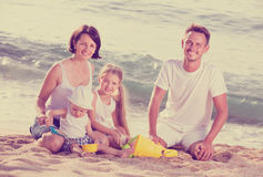 Family with children playing at beach Royalty Free Stock Images