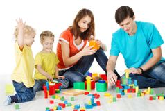 Family with Children Playing Toys Blocks, Kids Parents on White Stock Photo