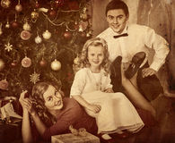 Family with children pose under Christmas tree. Black and white retro family portrait Stock Photo