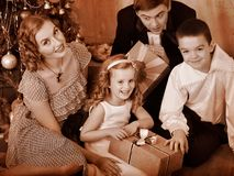 Family with children  receiving gifts. Royalty Free Stock Images
