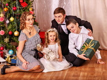 Family with children  receiving gifts under Royalty Free Stock Images