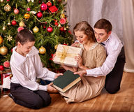 Family with children  receiving gifts under Stock Image