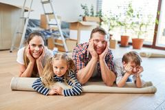 Family and children rest after moving stock photo