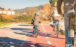 Family with children riding bicycles in the nature Stock Photography
