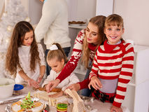 Family with children rolling dough in Xmas kitchen. Stock Photography