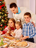 Family with children rolling dough in Xmas kitchen Stock Photography