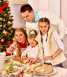 Family with children rolling dough in Xmas kitchen Royalty Free Stock Photography