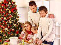 Family with children rolling dough in Xmas kitchen Royalty Free Stock Images