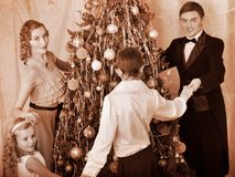 Family with children round dance  Christmas tree. Stock Photo