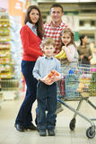 Family with children shopping fruits Royalty Free Stock Images