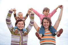 Family with children on shoulders on sky Royalty Free Stock Photography
