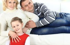 Family with children sitting Royalty Free Stock Images