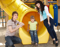 Family with children on slide outdoor. Royalty Free Stock Photos