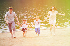 Family with children in summer on beach Stock Photo