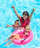 Family in swimming pool. Family with children in swimming pool. Summer outdoor Stock Photo