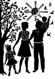 Family with children on walk. Young happy family with two children walking on the background of the tree, the sun and the birds in the summer Stock Images