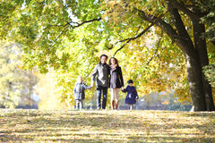 Family with children walking in autumn park Royalty Free Stock Photos