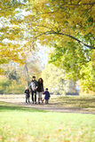 Family with children walking in autumn park Stock Photo