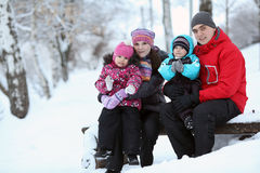 Family with children walking in winter Royalty Free Stock Photo