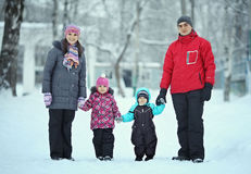 Family with children walking in winter Stock Photography