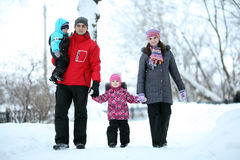 Family with children walking in winter Royalty Free Stock Photography