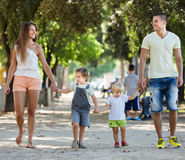 Family with childrens playing at park. Happy family with childrens playing at park royalty free stock photography