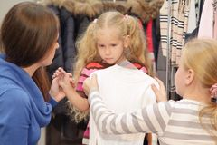 Family chooses clothes in shop. Family chooses clothes in a shop a little girl do not like a thing Stock Photography