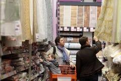 Family chooses curtains Stock Photos