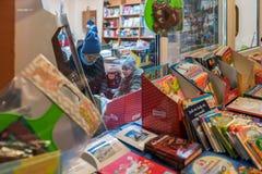 Family choosing books to buy