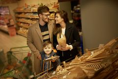 Family choosing bread Royalty Free Stock Images